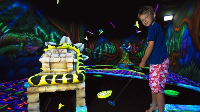 Tate Parker playing mini golf at Tabatinga.