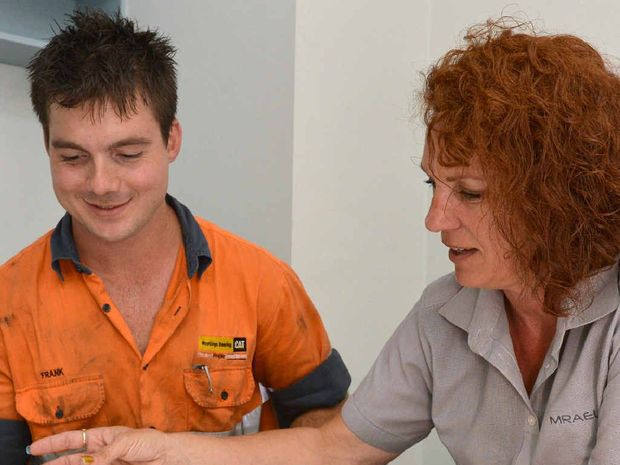 Fourth-year apprentice diesel fitter Frank Lunn, with MRAEL apprentice specialist Kylie Bollard, reviews his paperwork as he nears the end of his apprenticeship.