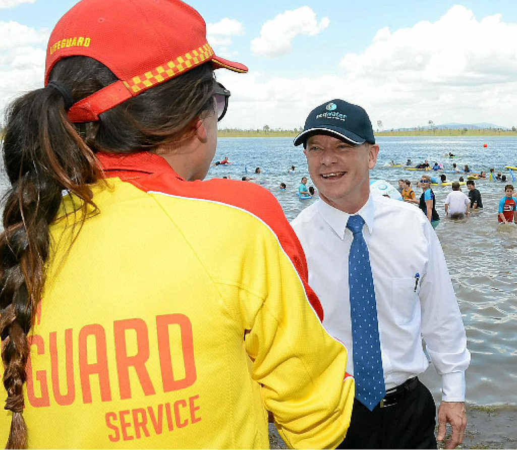 IN GOOD HANDS: The Premier meets a lifeguard.