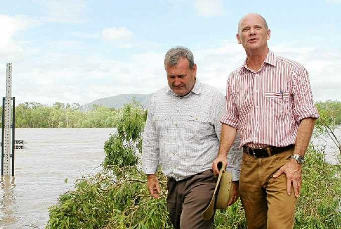 DOING THEIR LEVEL BEST: Police Minister Jack Dempsey and Campbell Newman inspect the Fitzroy River.