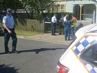 Police at a house where a body has been found at Southport. Photo: Seven News