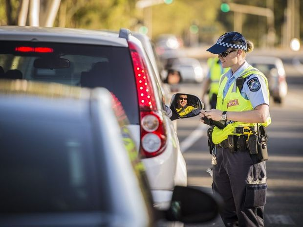 Gladstone police conducting random breath testing operations on Glenlyon Road, Gladstone.
