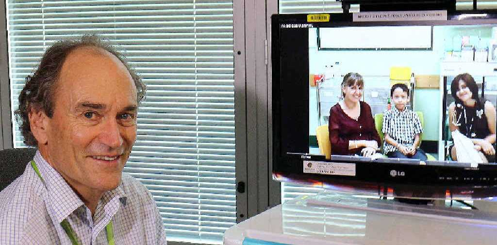 Dr Michael Williams chats with Kathy Susila (left), Indra Susila and Dr Sarah McLay during a telemedicine conference between Proserpine Hospital and Mackay Base Hospital.