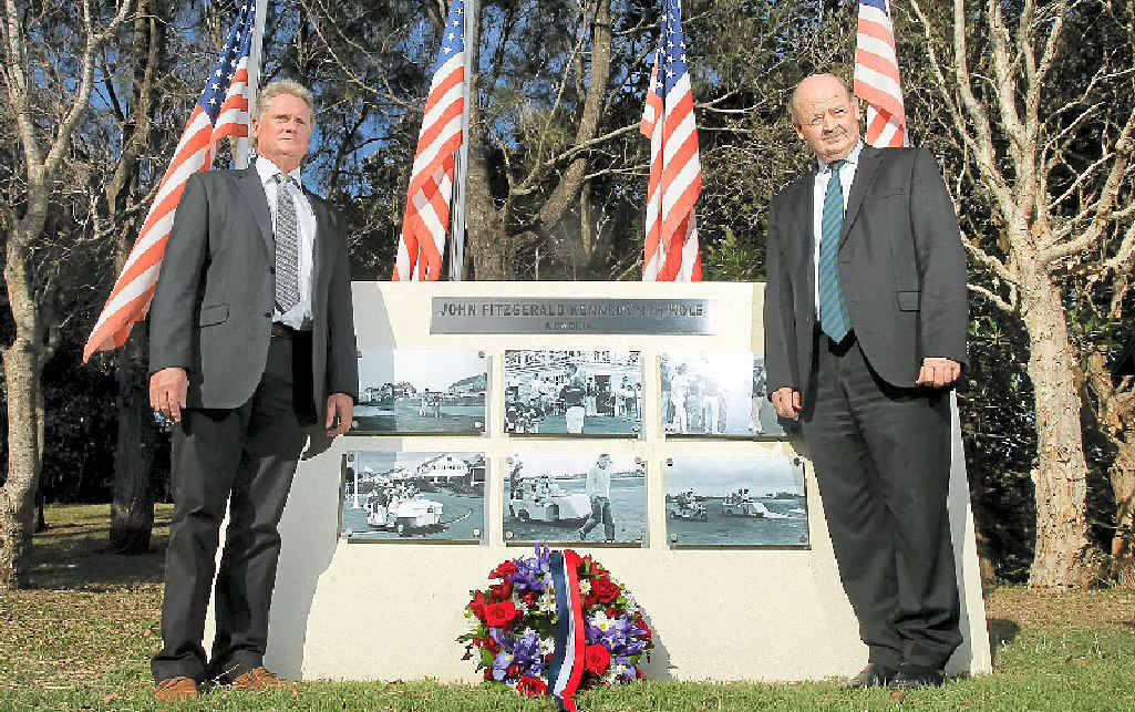 CHANGING OF THE GUARD: The then Palmer Coolum Resort general manager Bill Schoch (right) and assistant general manager Simon Stodart lay a wreath on the 50th anniversary of the assassination of John F Kennedy.