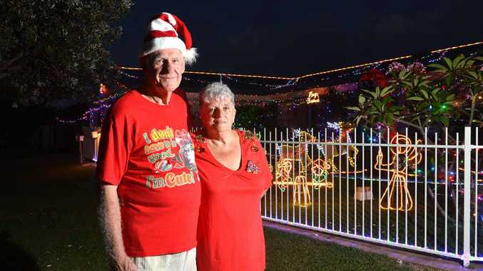 LOTS OF LIGHTS: Bruce and Het Warrell are raising money for Camp Quality by displaying their Christmas lights.