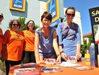 SIGNING UP: Esther Grogg and Pam Tucker (front) and behind them, from left, Christine Hahn, Liora Claff and Anasuya Claff at Aldi supermarket in Lismore.