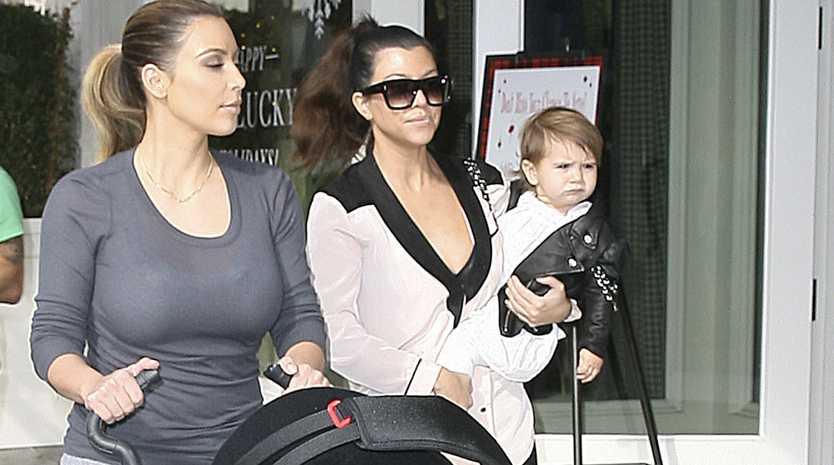 Kim and Kourtney Kardashian with their daughters.