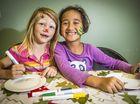 Shikira Davis, 6, and Rosie Petera enjoy the arts and crafts.