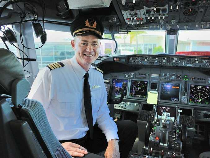 Captain Brett Jensen landed the first QantasLink 737 in Gladstone on Monday morning, helping thousands of Bechtel employees make it home for Christmas.