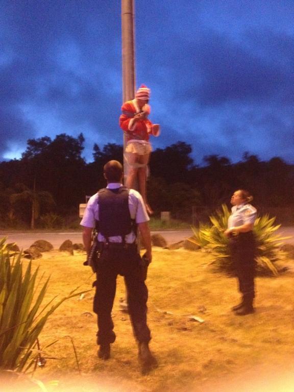 Police call a halt to Timothy Hend's and Callum Cudahy's Christmas stunt.