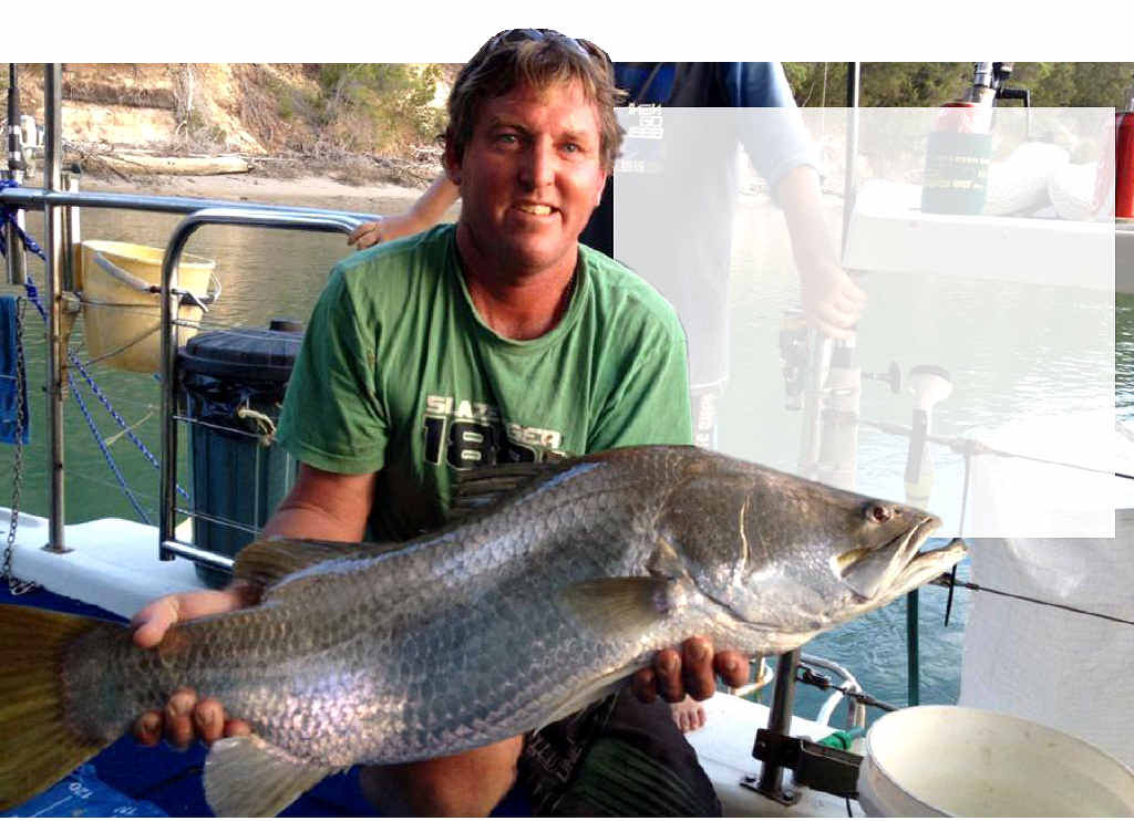 Russell De Serio and his cracking barramundi caught on Christmas Day.