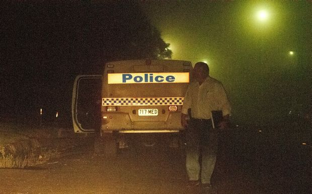 Police at the scene of the violent attack on a taxi driver and two residents.