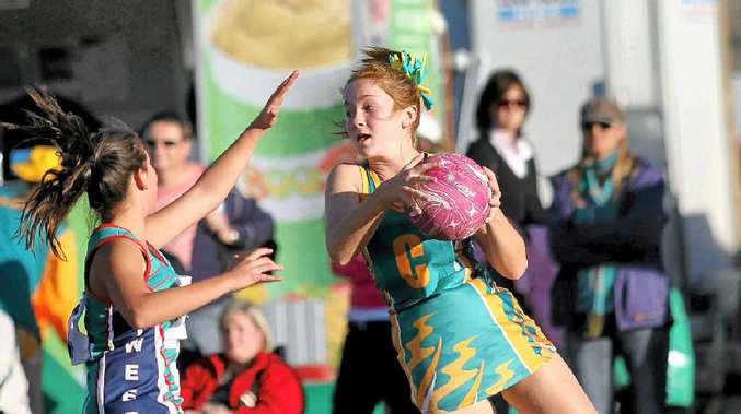 Pine Rivers C Renee Devlin looks for support around Tweeds C Kayla Palmer. The sport is expected to boom with new facilities. Photo: Karen Harper