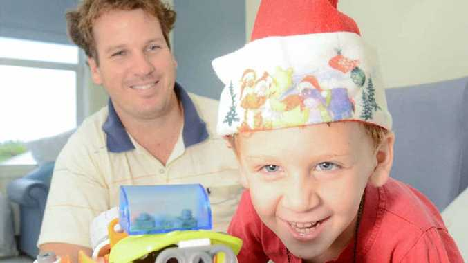 FEELING BETTER: Theo Wiblen with dad Ray Wiblen in Grafton Base Hospital on Christmas Day. Photos Adam Hourigan