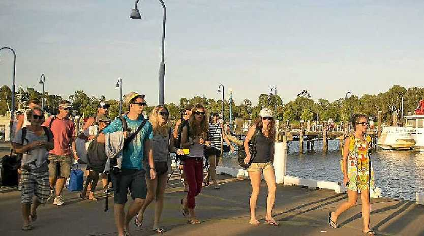 Holidaymakers evacuated from Heron Island arrive at Gladstone on Thursday.
