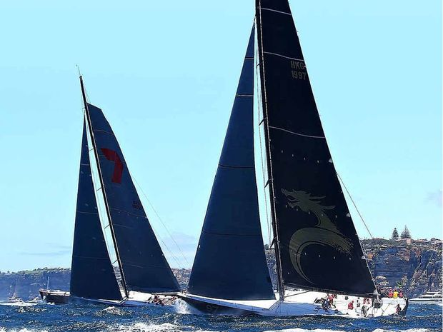 OUT IN FRONT: Wild Oats XI and Beau Geste lead the field out to sea during the 2013 Sydney to Hobart yesterday.