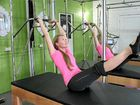 Pilates instructor is fit for action in the bush
