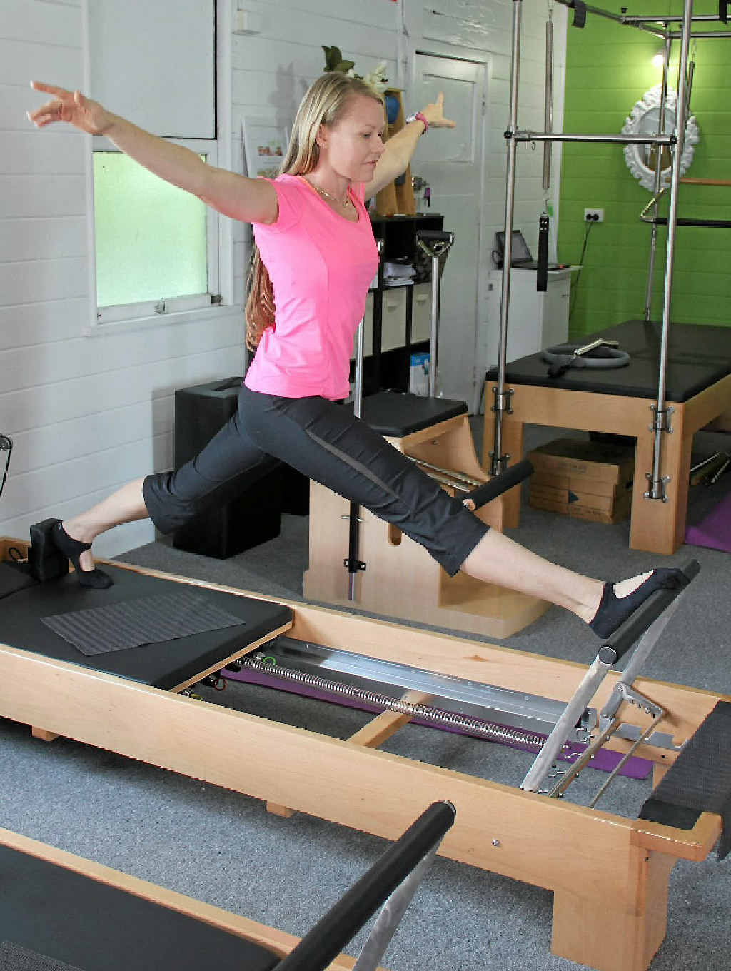 Trissi Pearce on one of the many pilates machines in Marian.