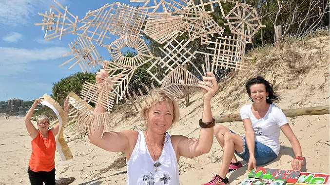 BEACH CRAFT: Pamela Walsh, Julie Weatherill and Emma Ferris with their dune art.