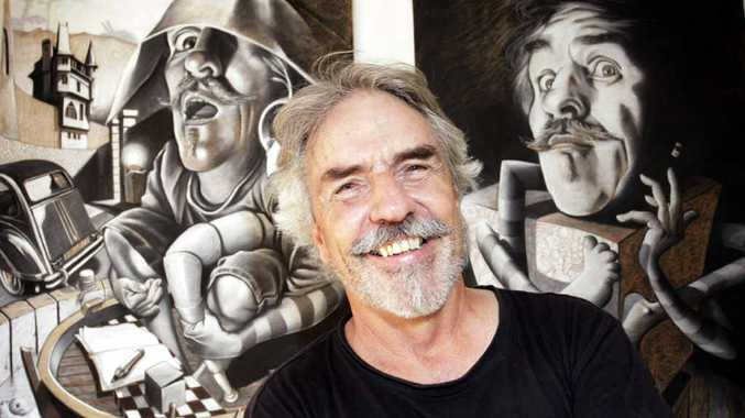 HERE'S LOOKING AT YOU: Woodford art teacher Peter Hollard with some of his self portraits.