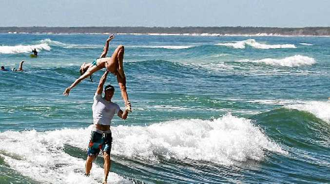 Fred and Lily Branger grab plenty of attention with their tandem surfing at Caloundra.