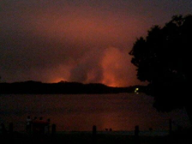 The fire north of Lennox Head looming over Lake Ainsworth.