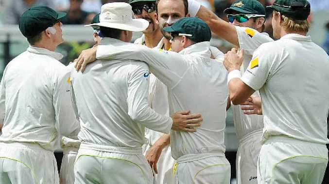 GOTCHA: Teammates congratulate Nathan Lyon after dismissing Ben Stokes on the third day of the Boxing Day Ashes Test at the MCG in Melbourne, yesterday. He snared five wickets.