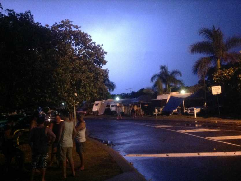 Two people were taken to hospital after lightning struck the ground at Cotton Tree Holiday Park.