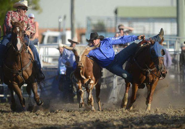Heath Nichols lines up the steer in the steer wrestling.