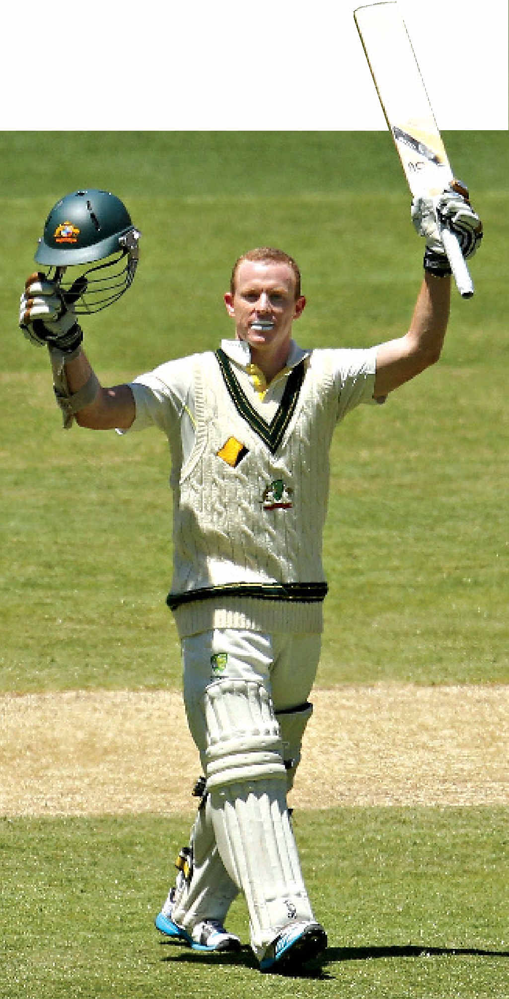 TON UP: Australian opener Chris Rogers celebrates reaching his second century at the MCG yesterday.