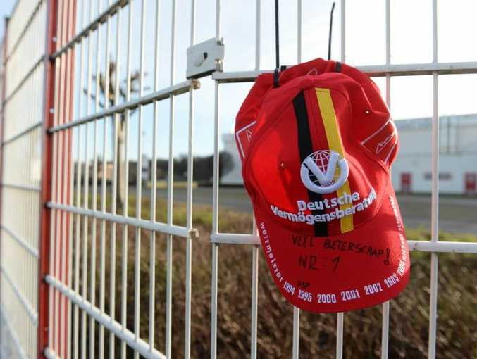 A fan's cap hangs on the fence of the karting circuit owned by German former Formula One champion Michael Schumacher.