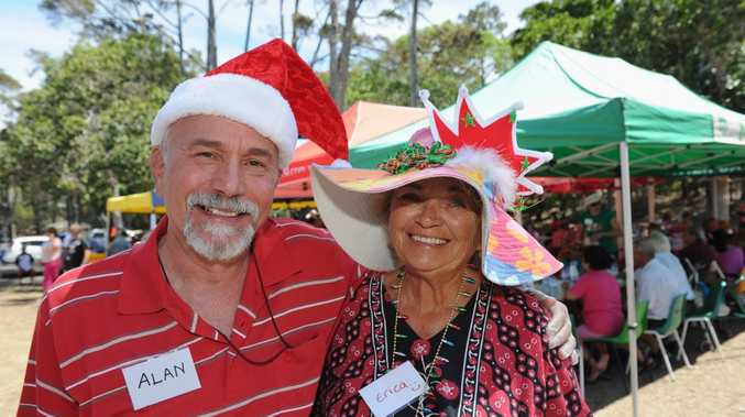 CHRISTMAS TREAT: Volunteers Alan DeBeer with guest Erica Illes pictured enjoying a great day out at the annual Christmas picnic.