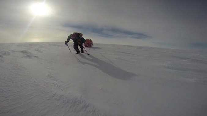 Dr Geoff Wilson has just passed the South Pole with his boob sled in tow.