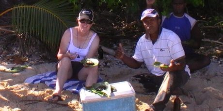 Mrs Austrin on holiday in Fiji eating the fish she believes made her so ill.
