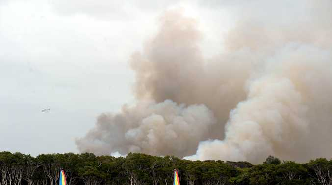 RFS members are continuing work to keep the Lennox Head fire along The Coast Road under control.