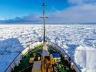 A supplied image obtained Saturday, Dec. 28, 2013 of an Antarctic-bound cruise liner carrying 50 tourists and 20 crew members, wedged in thick sheets of sea ice. The ship had been on a multi-day tour from New Zealand to visit several sites along the edge of Antarctica.