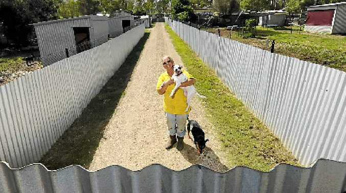 SALLY Rogers, of Happy Paws Haven at Eatonsville, with the new galvanised fencing she has around the property.