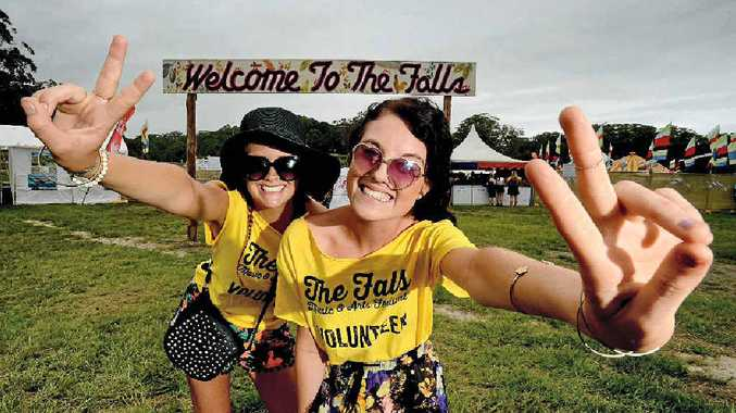 WELCOME: Festival volunteers Amelia Dlask, of Ocean Shores, and Amber Booler, of the Gold Coast, pictured meeting and greeting at The Falls Festival main entrance.