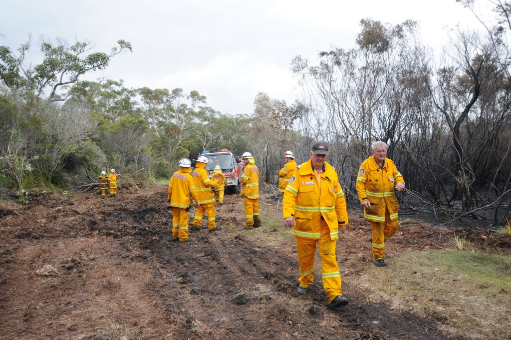 RFS Fire fighters on Fire trail at the Lennox Head fires on Tuesday. Photo Doug Eaton / The Northern Star