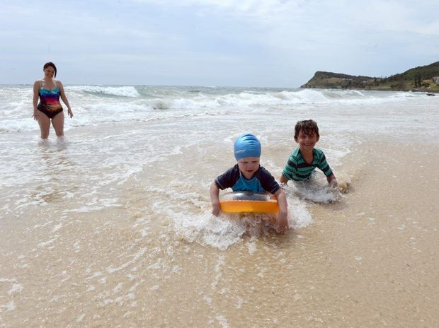 Three year old Rory Doherty from the Gold Coast and six year old Xavier Prescott from Perth make the most of the high tide at Lennox Head.