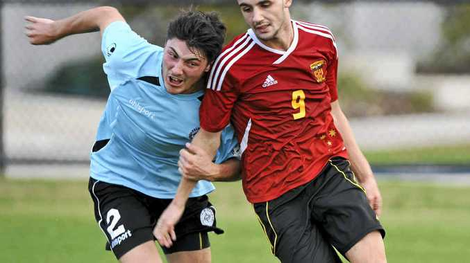 FOCAL POINT: The Fire's Niko Bechar, right, gets the better of Palm Beach's Riley Dillon last July at Stockland Park.