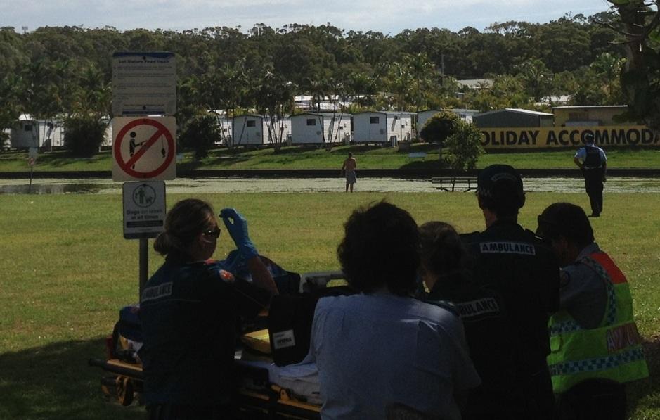 Police talk to a man at Nelson Park, Alexandra Headland.