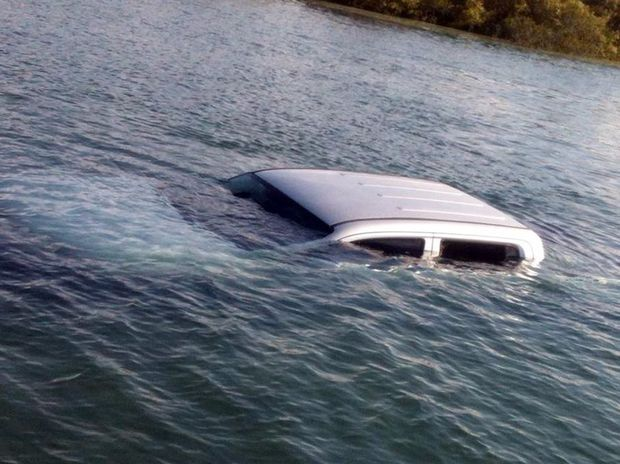 A vehicle submerged in Moon Creek on Fraser Island.