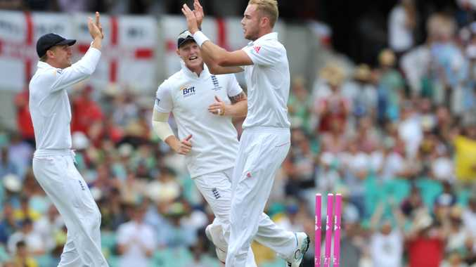 England's Stuart Broad (right) celebrtes taking the wicket of Australia's David Warner on Day 1 of the fifth Ashes Test at the SCG in Sydney, Friday, Jan. 3, 2014.