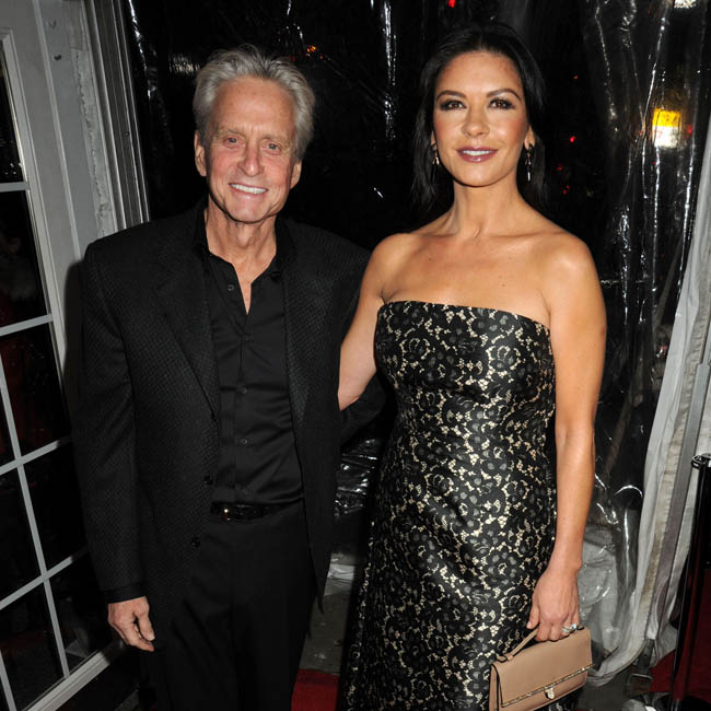 Hollywood stars Catherine Zeta-Jones and Michael Douglas have reunited to spend the New Year with their children.