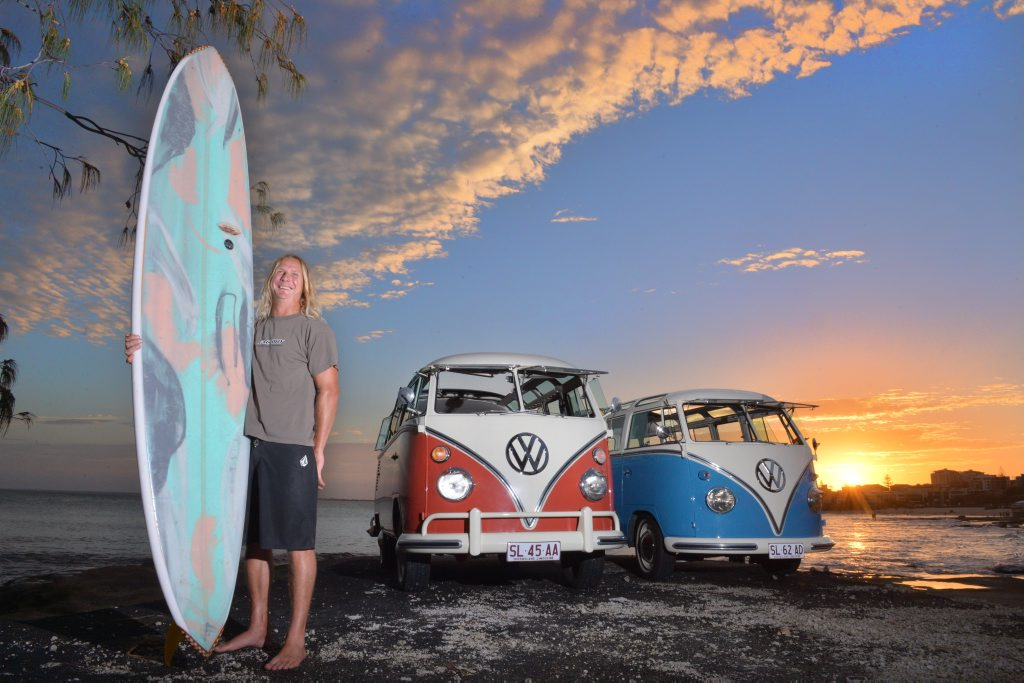 Michael Flocke with his classic kombis that will cease production in Brazil. Photo: John McCutcheon / Sunshine Coast Daily