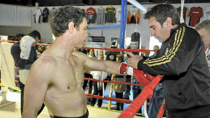 TEAMING AGAIN: Toowoomba's world champion boxer Michael Katsidis in the gym with Brendon Smith during a home visit last July.