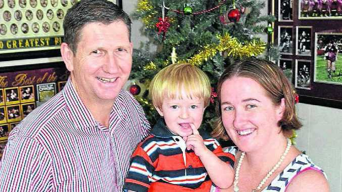 WHAT A CHANGE: Cobi Gilkinson was fighting for his life in a Brisbane hospital a year ago. Celebrating his recovery are Queensland Minister for Health Lawrence Springborg and Cobi's mother Leanne.