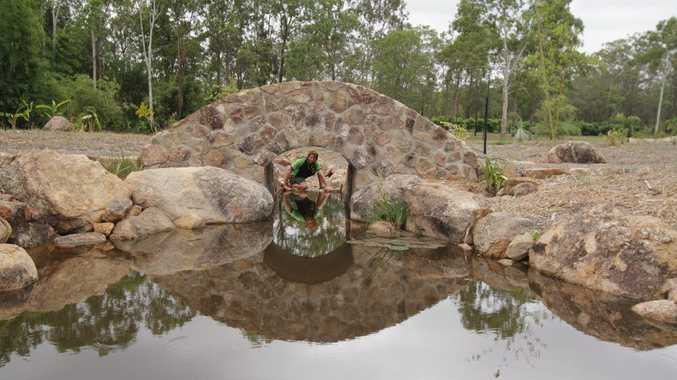Janne Nilsson at the stone bridge, one of the features at Bamboo Land on the Burrum River.