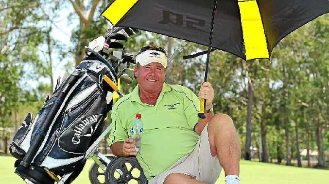 SITTING IT OUT: Steve Troon takes a break from the heat at Tewantin Noosa golf course.